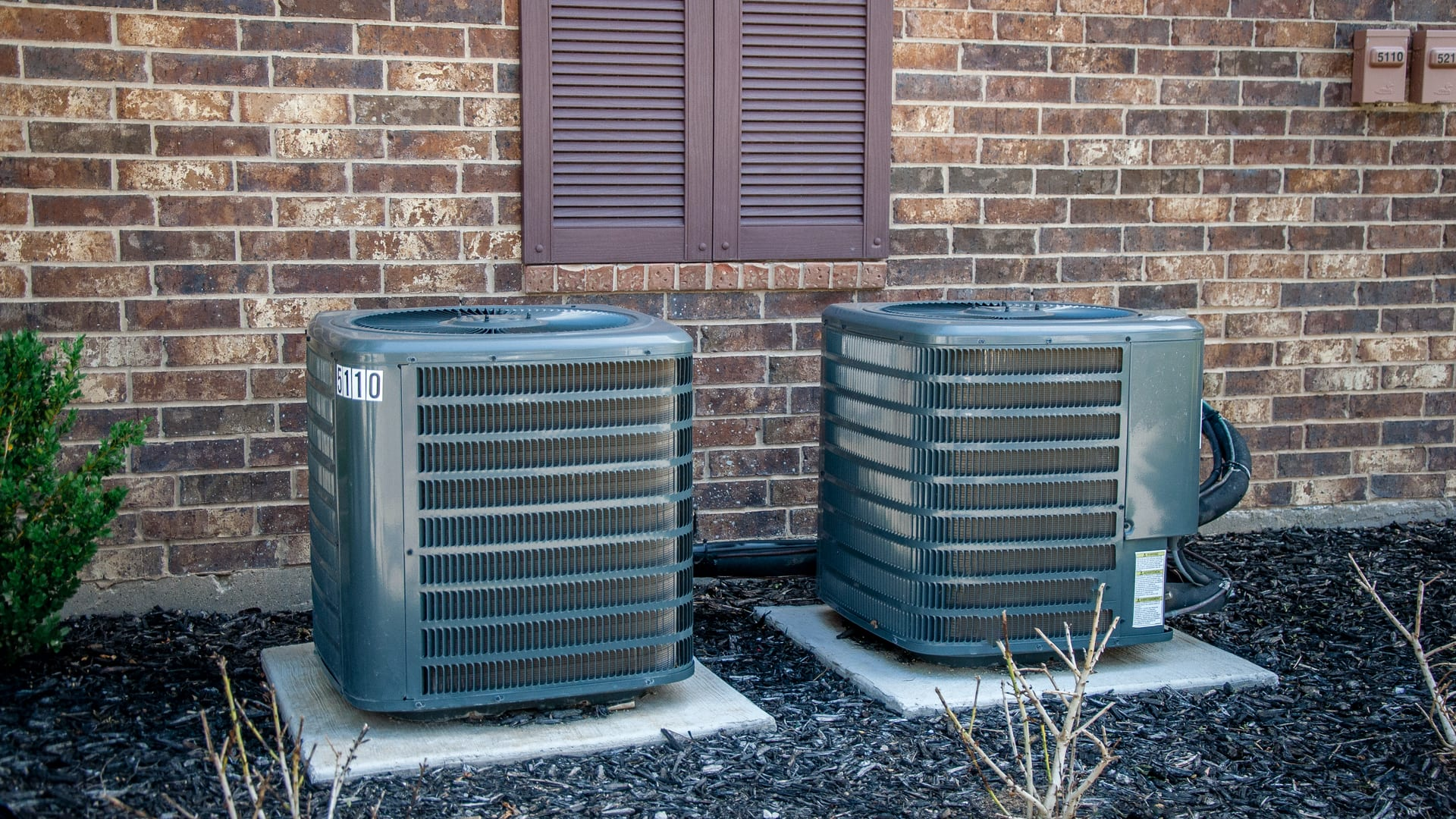A split type HVAC system outside of a building.