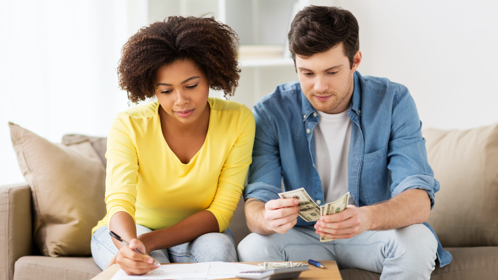A young couple budgeting their money