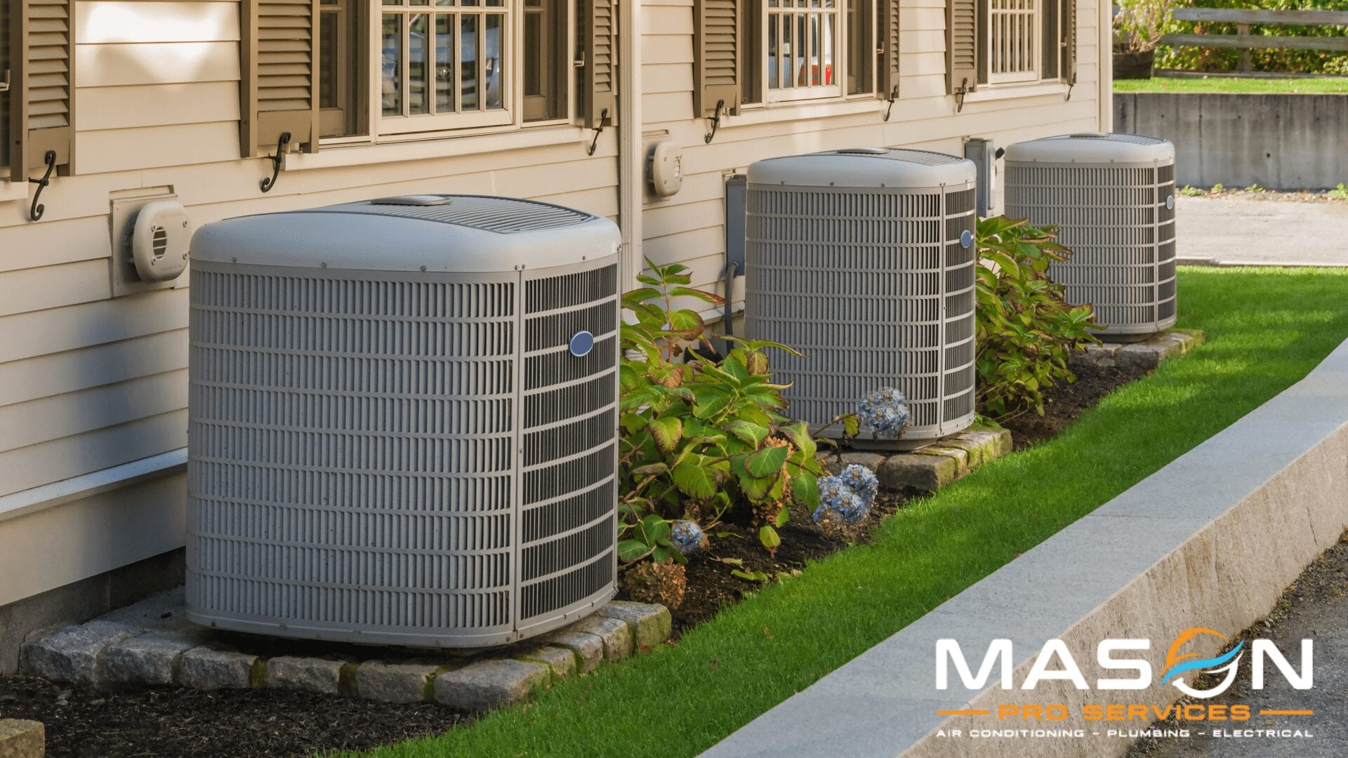 A line of air conditioner units by houses